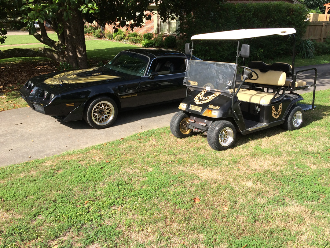 Yellow Ezgo Golf Cart Bos on